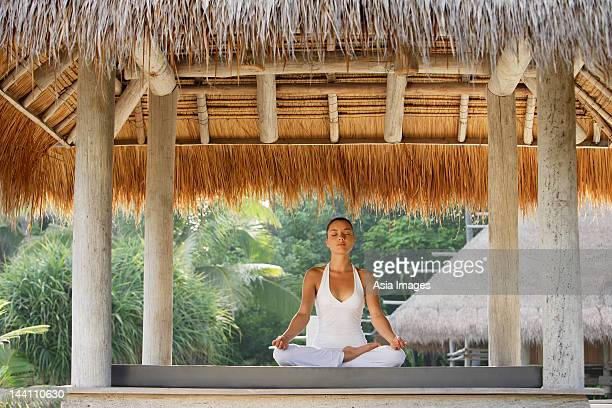 woman doing yoga in tropical sala