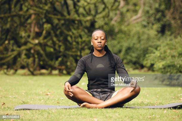 Woman doing yoga meditation exercise in park