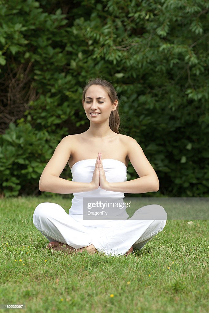 Woman doing yoga meditation : Stock Photo