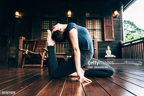 Woman doing yoga on balcony