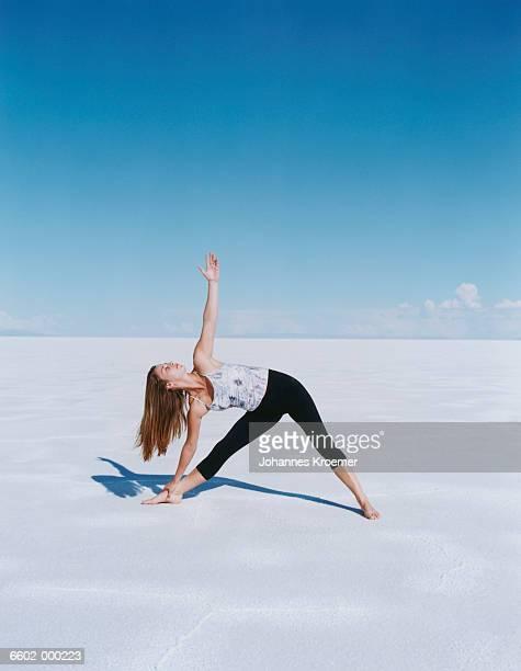 Woman doing Yoga on Salt Flats