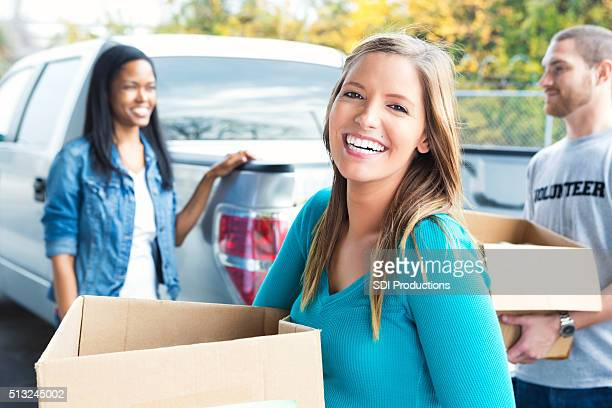Woman donating items to charity
