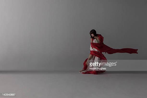 woman draped in flowing silk