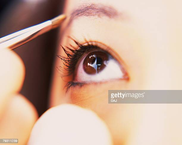 A Woman Drawing Eyebrow, Looking Up, Differential Focus