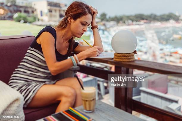 Woman drawing in coloring book