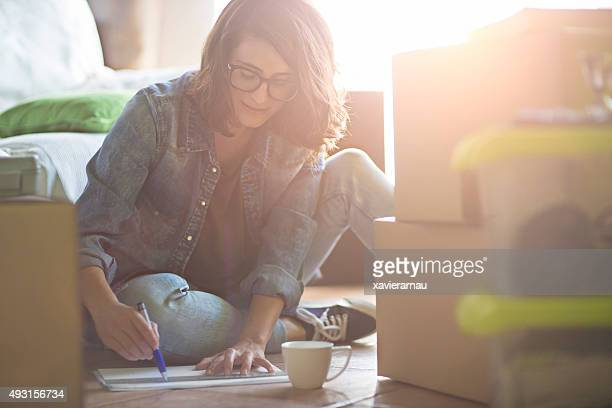 Woman drawing the new home decoration