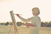 Woman drawing the oil painting on the beach
