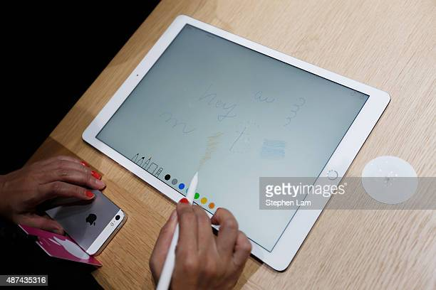 A woman draws on an Apple iPad Pro with an Apple Pencil in the demo area after a special event at Bill Graham Civic Auditorium on September 9 2015 in...