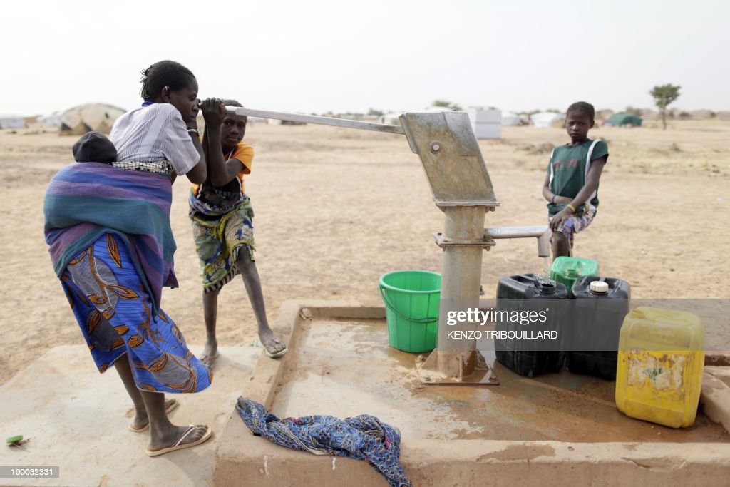A woman draws water on January 24, 2013 from a pump in a refugee camp set in Menteao, near the Malian border. The conflict in Mali has caused nearly 150,000 people to flee the country, while about another 230,000 are internally displaced, the UN humanitarian agency said on January 15, 2013. According to OCHA, the UN High Commissioner for Refugees has registered 144,500 refugees in neighbouring countries -- 54,100 in Mauritania, 50,000 in Niger, 38,800 in Burkina Faso and 1,500 in Algeria.