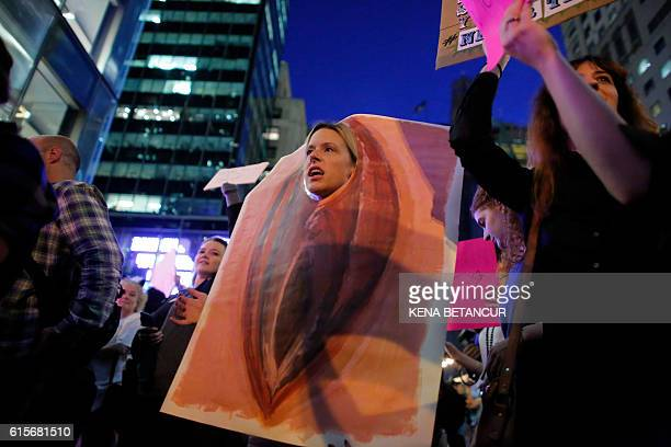 A woman dress up as a vagina takes part of a protest outside Trump Tower to protest against Republican presidential candidate Donald Trump for his...