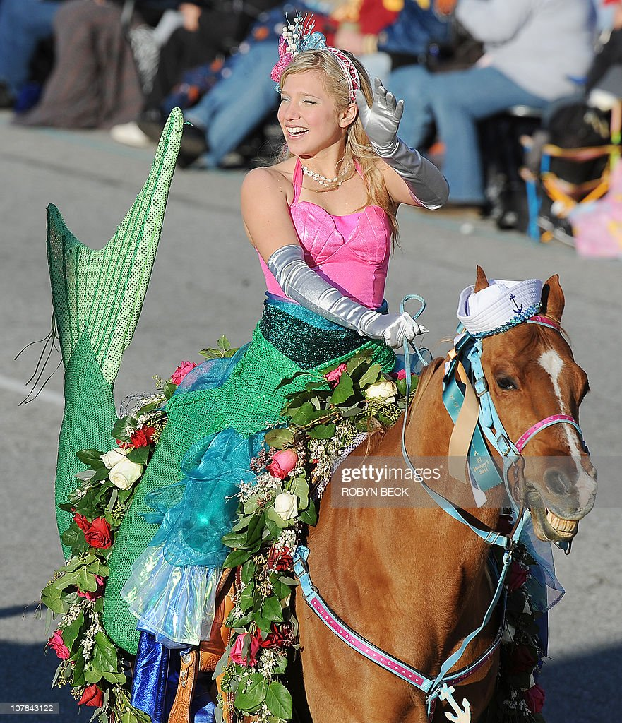 a woman dressed as a mermaid rides a hor pictures getty images