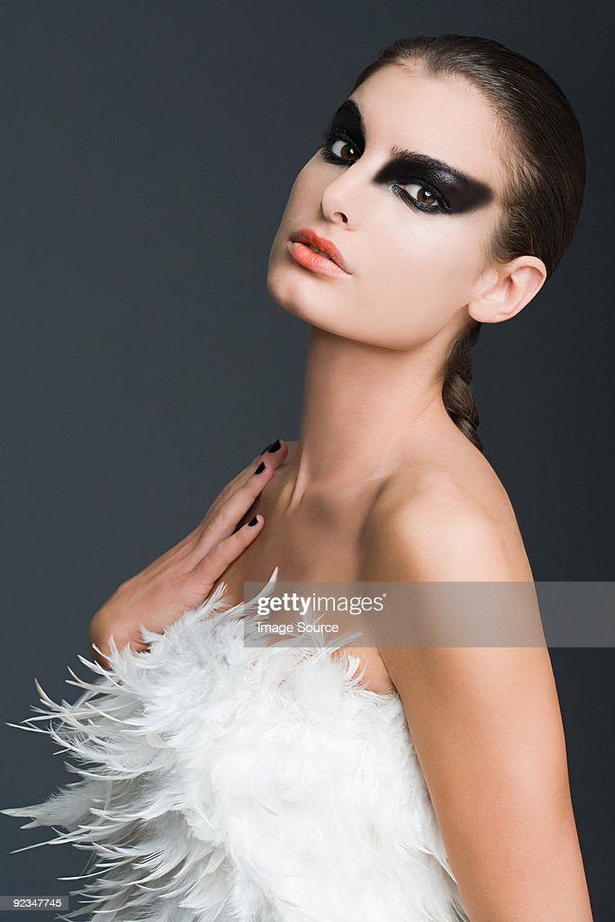 Woman dressed as a swan : Stock Photo