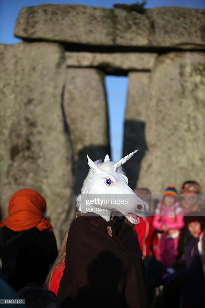 A woman dressed as a unicorn watches the sun rise, as druids, pagans and revellers take part in a winter solstice ceremony at Stonehenge on December 21, 2012 in Wiltshire, England. Predictions that the world will end today as it marks the end of a 5,125-year-long cycle in the ancient Maya calendar, encouraged a larger than normal crowd to gather at the famous historic stone circle to celebrate the sunrise closest to the Winter Solstice, the shortest day of the year.