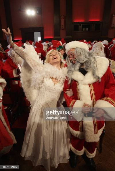 Women dressed as santa stock photos and pictures getty