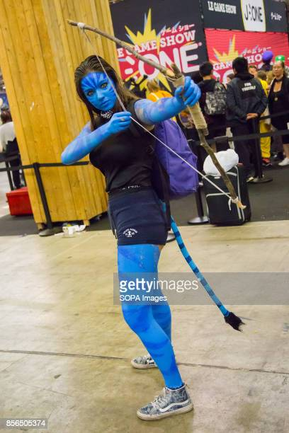 A woman dressed as Avatar character is pictured during the 24th edition of the Paris Manga SciFi Show mostly devoted to Japanese entertainment and...