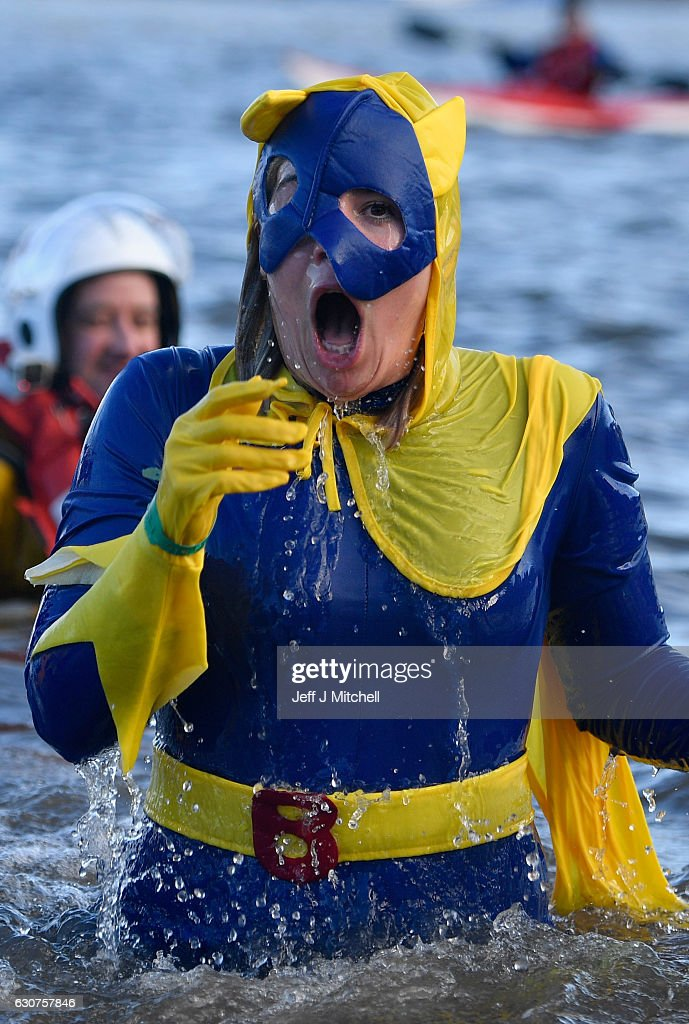 A woman dressed as Bananaman reacts to the cold water as she joins around 1,000 New Year swimmers, many in costume, in front of the Forth Rail Bridge during the annual Loony Dook Swim in the River Forth on January 1, 2017 in South Queensferry, Scotland. Tens of thousands of people gathered last night in Edinburgh and other events across Scotland to see in the New Year at Hogmanay celebrations.