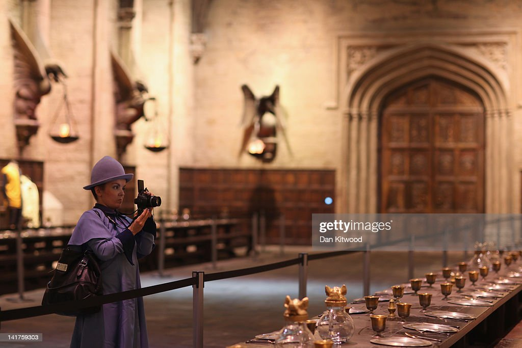 A woman dressed as Harry Potter character Fleur Delacour walks through the 'Great Hall' at the new Harry Potter Studio Tour at Warner Brothers Leavesden Studios on March 23, 2012 in London, England. The studio, which includes the actual sets and special effects departments where the films were created and shot, goes on public display on March 31, 2012.