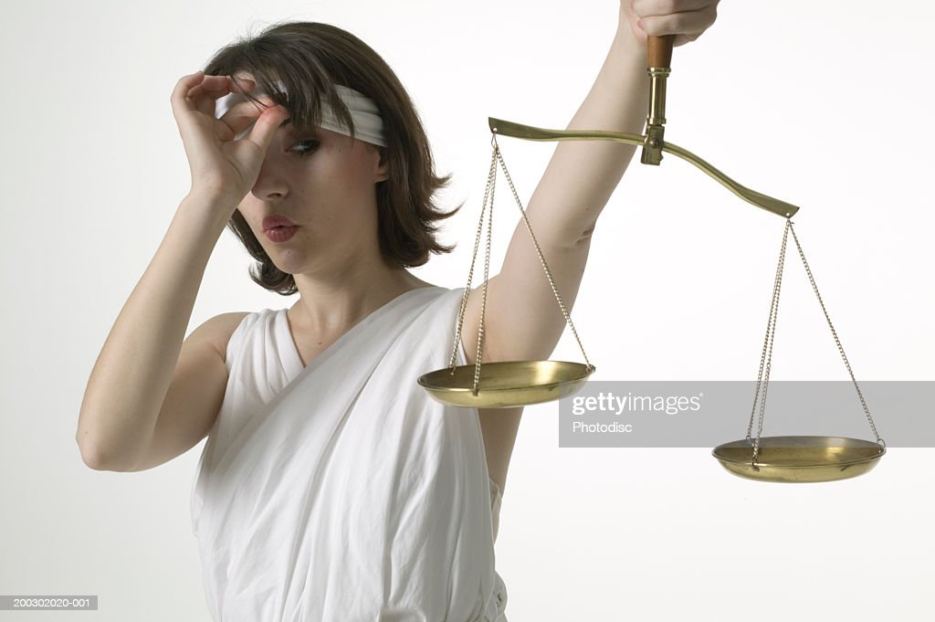 Woman Dressed As Lady Justice Peeking At Scales Stock ...