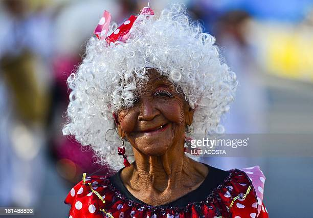 A woman dressed as 'Negrita Puyol' takes part in the third day of carnival in Barranquilla Colombia on February 11 2013 Barranquilla's Carnival a...