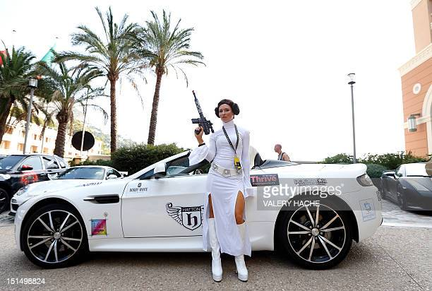 A woman dressed as Princess Leia from Star Wars poses infront of a luxury sport car during the fifth Cannonball event on September 8 2012 in...