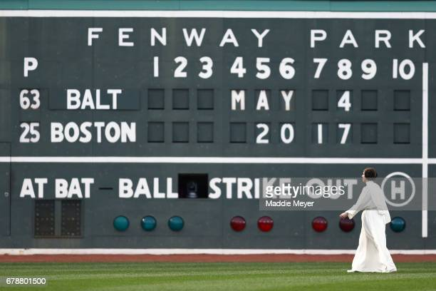 A woman dressed as Princess Leia from the Star Wars franchise walks in front of the Green Monster as part of Star Wars day at Fenway Park before the...