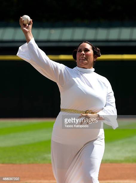 A woman dressed as Princess Leia throws out the first pitch durring Star Wars Day before the Chicago White Sox take on the Minnesota Twins at US...