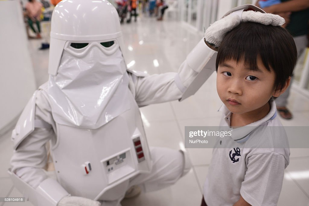 A woman dressed as the character Snowtrooper from a famous movie Star Wars plays with a man during the Star Wars day in Bangkok, Thailand on May 4, 2016.