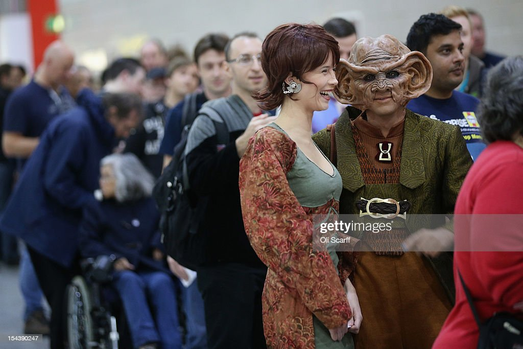 A woman dressed as the Star Trek character 'Leeta' (C) and man dressed as 'Rom' (2R) arrive to attend the 'Destination Star Trek London' convention at the ExCeL centre on October 19, 2012 in London, England. The three-day convention, which opened to the general public today, will be attended by all five actors who played captains throughout the 46-year-old series.
