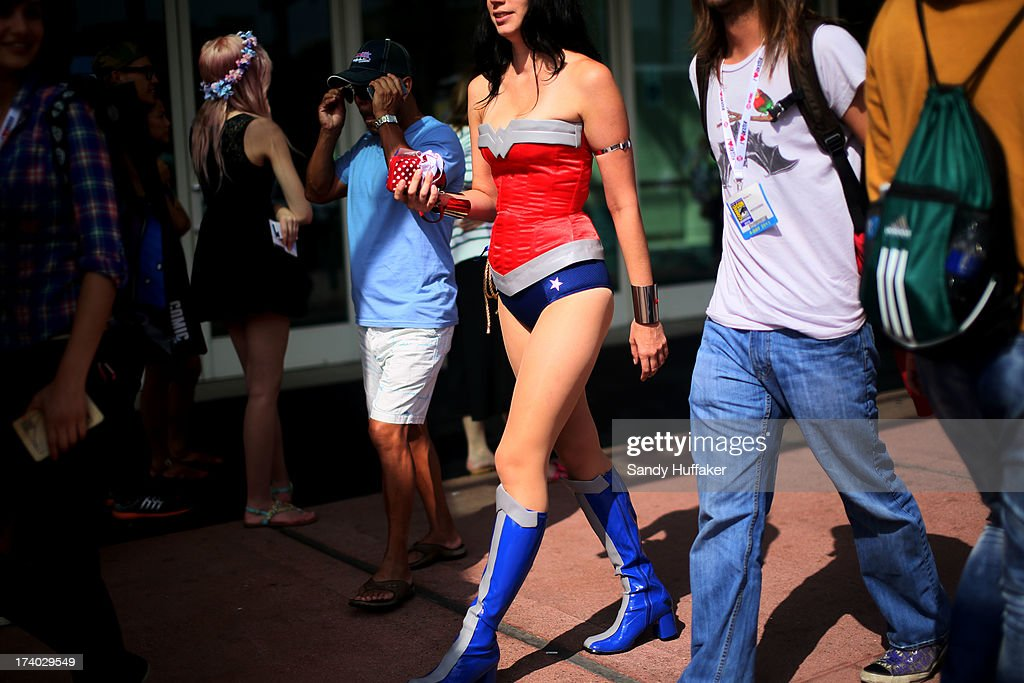 A woman dressed as Wonder Woman attends Comic Con at the San Diego Convention Center on July 19, 2013 in San Diego, California. Comic Con International Convention is the world's largest comic and entertainment event and hosts celebrity movie panels, a trade floor with comic book, science fiction and action film-related booths, as well as artist workshops and movie premieres.