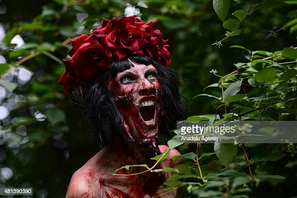 A woman dressed as zombie tries to catch runners during the Zombie race at the Izmailovo Park in Moscow Russia on July 19 2015 Runners of the Zombie...