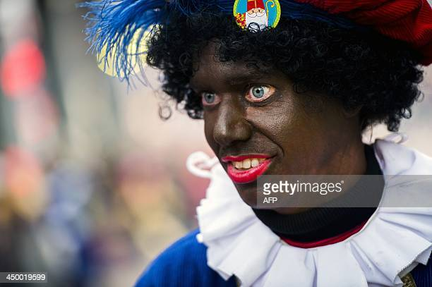 A woman dressed as Zwarte Piet takes part in the arrival of Sinterklaas during the traditional movein 'Intocht Sinterklaas' event in Groningen...