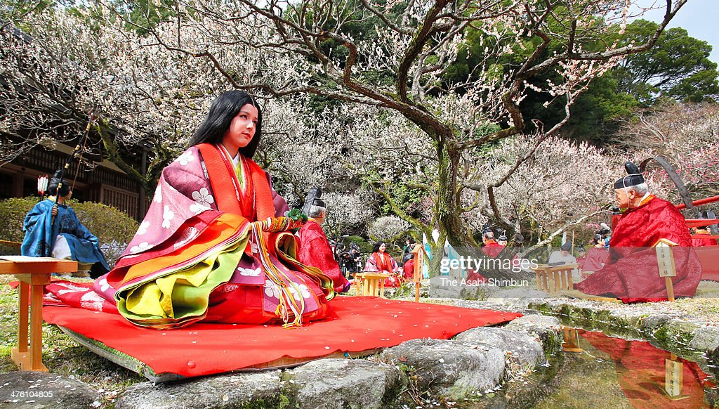 A woman dressed Heian period kimono sits along a stream during the Kyokusui No En Ancient Festival at Dazaifu Tenmangu shrine on March 2, 2014 in Dazaifu, Fukuoka, Japan. The ancient festival of Kyokusui-no Utage, which participants read Japanese poems, is thought to begin in 958 in Kyoto.