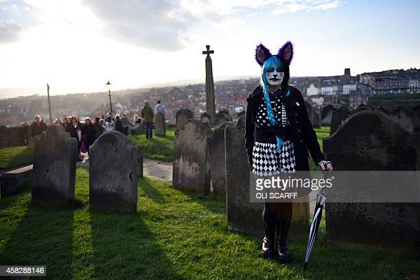 A woman dressed in a costume is pictured during the biannual 'Whitby Goth Weekend' festival in Whitby Northern England on November 2 2014 The WGW...