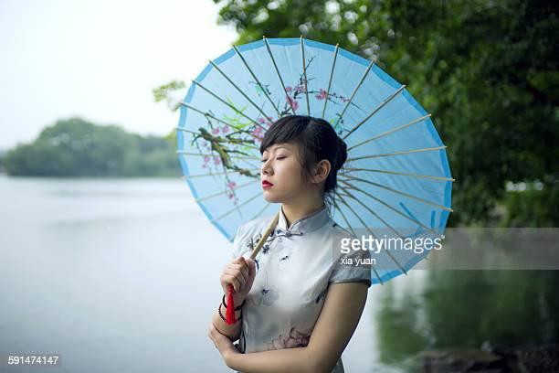 Woman dressed in Cheongsam in West Lake,Hangzhou