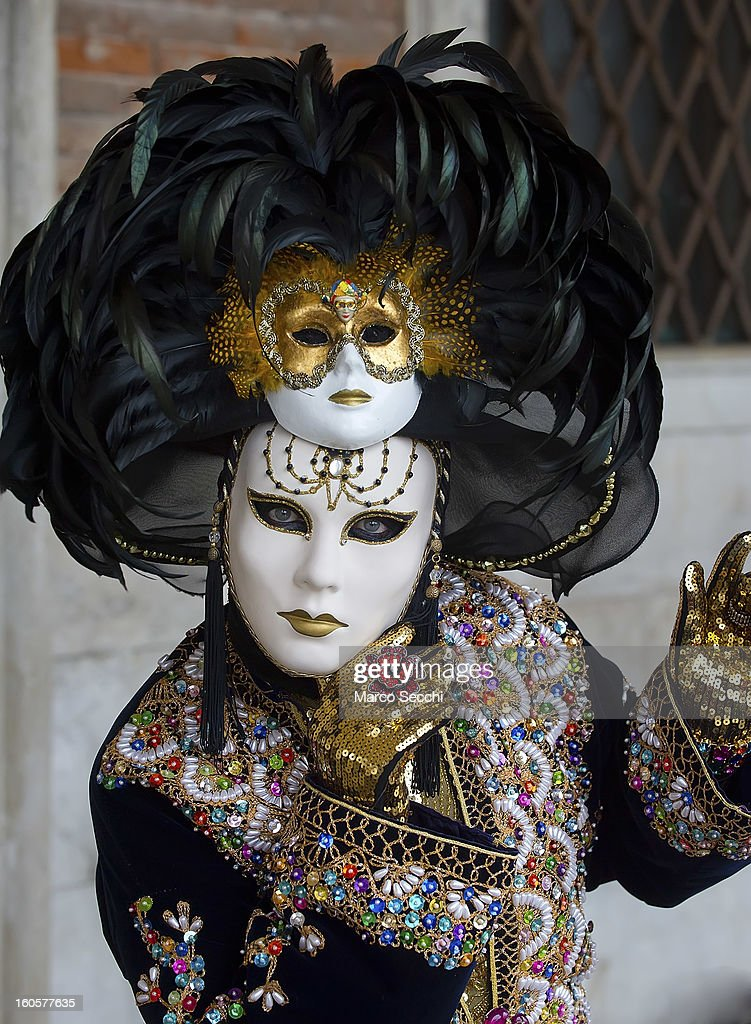 A woman dressed in costume poses in Saint Mark's Square ahead of the official opening of the Venice Carnival 2013 on February 3, 2013 in Venice, Italy. The 2013 Carnival of Venice will run from January 26 - February 12 and includes a program of gala dinners, parades, dances, masked balls and music events.