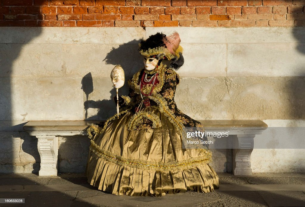 A woman dressed in costume poses in Saint Mark's Square during the Venice Carnival 2013 on February 4, 2013 in Venice, Italy. The 2013 Carnival of Venice runs from January 26 - February 12 and includes a program of gala dinners, parades, dances, masked balls and music events.