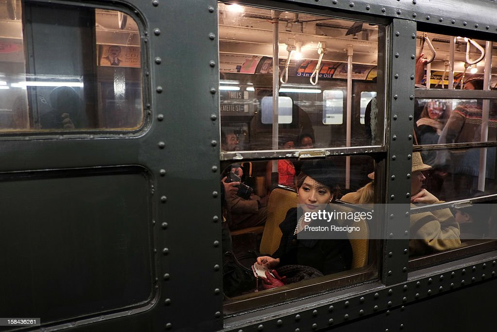 A woman dressed in period costume sits in a vintage New York City subway on December 16, 2012 in New York City. The New York Metropolitan Transportation Authority (MTA) runs vintage subway trains from the 1930's-1970's each Sunday along the M train route from Manhattan to Queens through the first of the year.