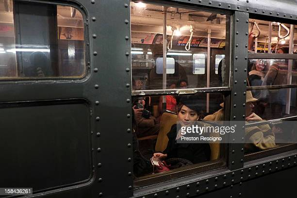 A woman dressed in period costume sits in a vintage New York City subway on December 16 2012 in New York City The New York Metropolitan...