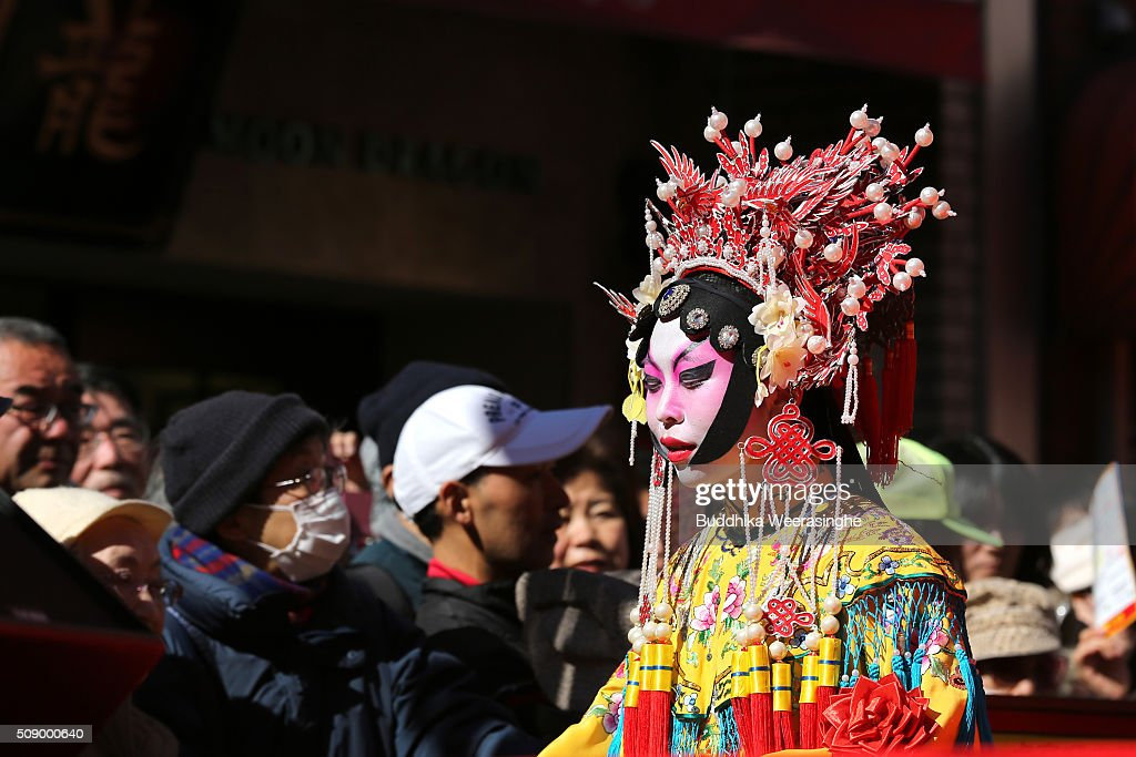 A woman dressed in traditional Chinese costume leaves from the stage after performing in celebration of the Chinese New Year at the Nankinmachi square, China Town on February 8, 2016 in Kobe, Japan. In Nankinmachi, the district known as Kobe Chinatown, tourists enjoyed Chinese food, lion dance and the parade organized to celebrate the Lunar New Year.