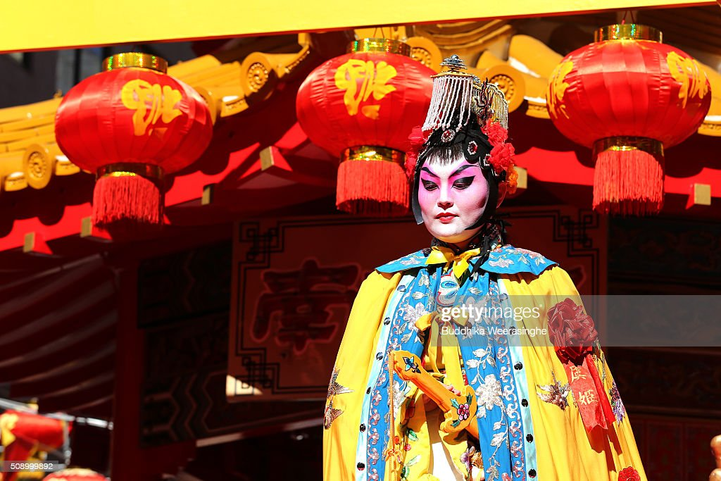 A woman dressed in traditional Chinese costume performs to celebrate the Chinese New Year on a stage at the Nankinmachi square, China Town on February 8, 2016 in Kobe, Japan. In Nankinmachi, the district known as Kobe Chinatown, tourists enjoyed Chinese food, lion dance and the parade organized to celebrate the Lunar New Year.