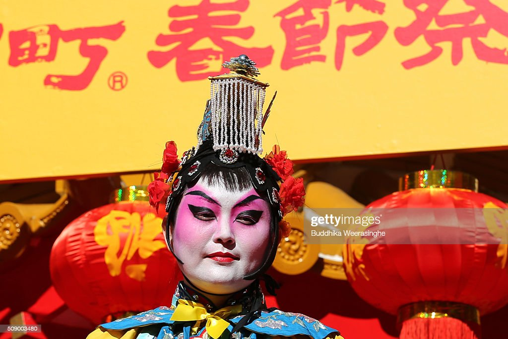 A woman dressed in traditional Chinese costumes waits to perform in celebration of the Chinese New Year on a stage at the Nankinmachi square, China Town on February 8, 2016 in Kobe, Japan. In Nankinmachi, the district known as Kobe Chinatown, tourists enjoyed Chinese food, lion dance and the parade organized to celebrate the Lunar New Year.