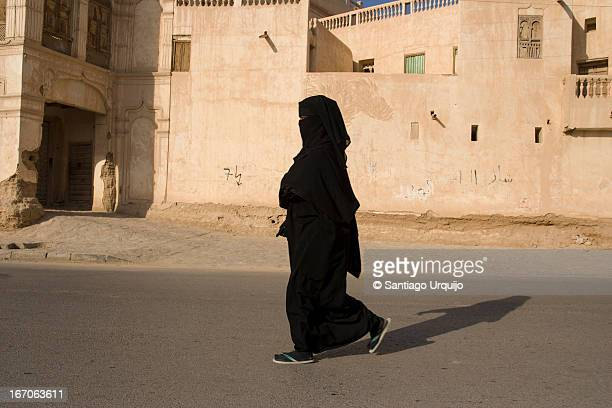 A woman dressed on a black niqab walking