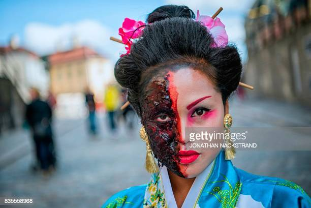 A woman dressed up as a zombie geisha participates in a zombie walk in Stockholm on August 19 2017 / AFP PHOTO / Jonathan NACKSTRAND
