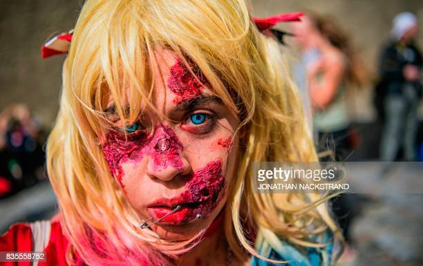 A woman dressed up as a zombie participates in a zombie walk in Stockholm on August 19 2017 / AFP PHOTO / Jonathan NACKSTRAND