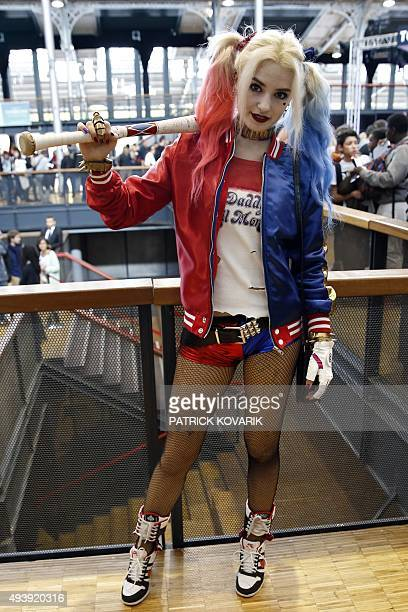 A woman dressed up as Harley Quinn a character from Batman poses during the first Comic Con convention at the Grande Halle de la Villette on October...