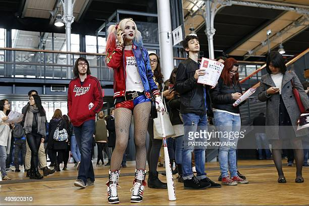 A woman dressed up as Harley Quinn a character from Batman takes part in the first Comic Con convention at the Grande Halle de la Villette on October...