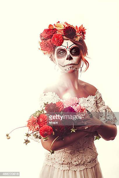 Woman dressed up for halloween sugar skull make-up