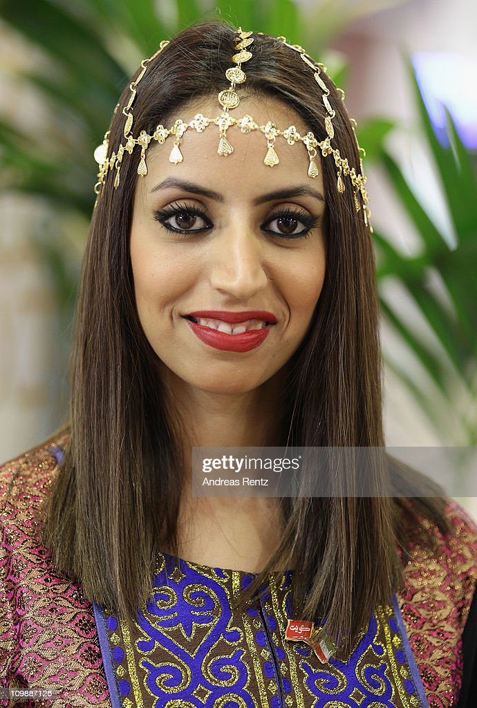 A woman dressed up in traditional clothes of Kuwait smiles at the ITB International tourism trade fair on March 9 2011 in Berlin Germany The ITB runs...