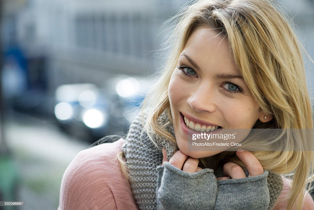 Woman dressed warmly with knit gloves and scarf