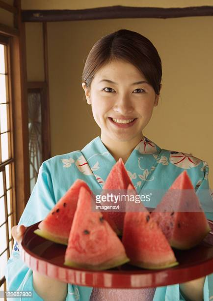 Woman dressed Yukata and watermelon